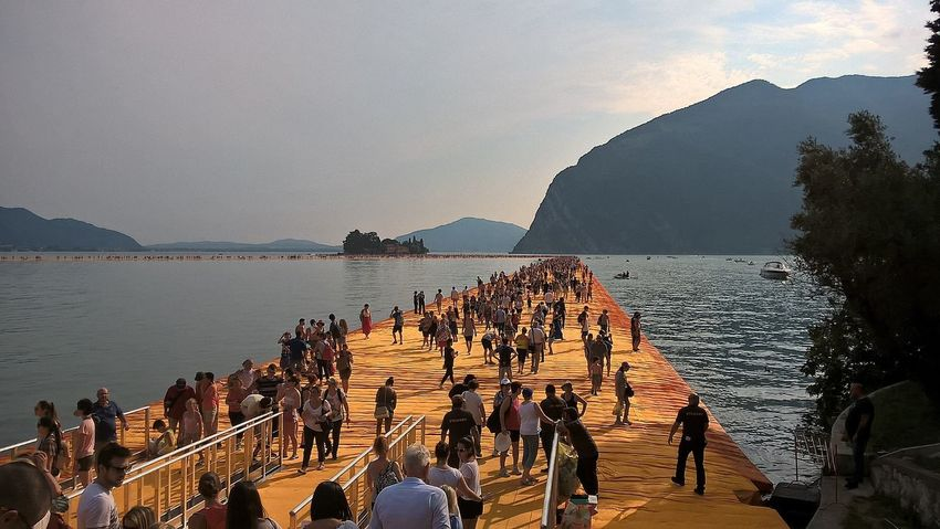 Beauty In Nature Christo Day Floating Piers Group Of People Idyllic Large Group Of People Leisure Activity Lifestyles Medium Group Of People Mixed Age Range Mountain Nature Outdoors Scenics Sky Tourism Tourist Tranquil Scene Tranquility Travel Destinations Unrecognizable Person Vacations Water