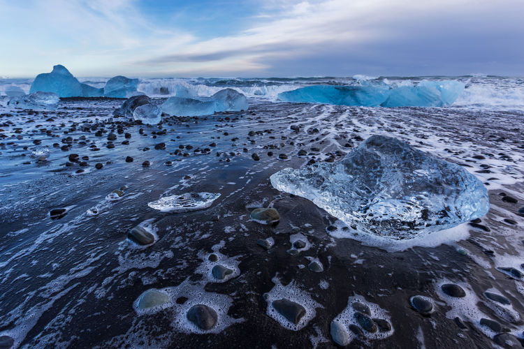 Pieces of ice on jokulsarlon diamond beach, iceland