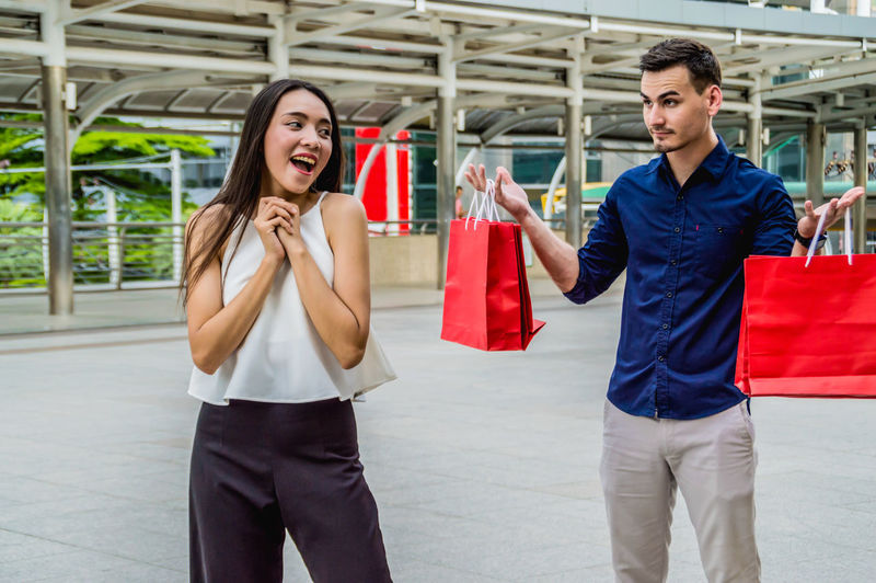 Asian  Attractive Background Bags Beautiful Bored Boyfriend Buyers Caucasian Center Cheerful City Clothes Commercial Consumer Consumerism Consumption  Couple Customer  Elegant Family Fashion Female Friends Gifts Girlfriend Glad Happy Hispanic Holding Husband Joyful Lifestyle Male Mall Man person Presents Pretty Purchase Purchasing Retail  Sale Sell Shopping Smile Tired Wife WOW Young