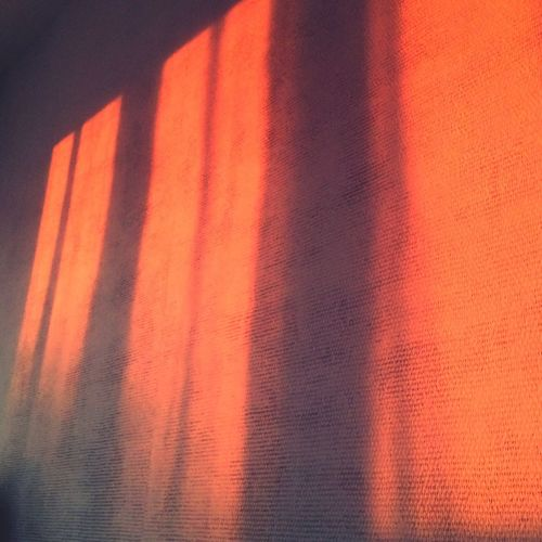 Light Wall Beauty France Sun Beauty In Ordinary Things Sunshine Orange Color Textile Full Frame Pattern Backgrounds No People Curtain Red Close-up Shadow Textured  Sunlight Material Nature Wall - Building Feature Focus On Shadow Window Indoors  Striped Day