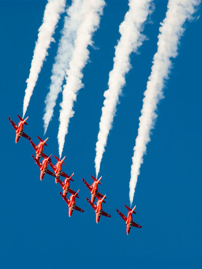 Aerobatics Air Force Air Vehicle Airplane Airshow Blue Clear Sky Day Fighter Plane Flying Formation Flying Low Angle View Mid-air Military Airplane No People Outdoors Red Red Arrows Royal Air Force Display Team Sky Smoke - Physical Structure Speed Stunt Teamwork Transportation