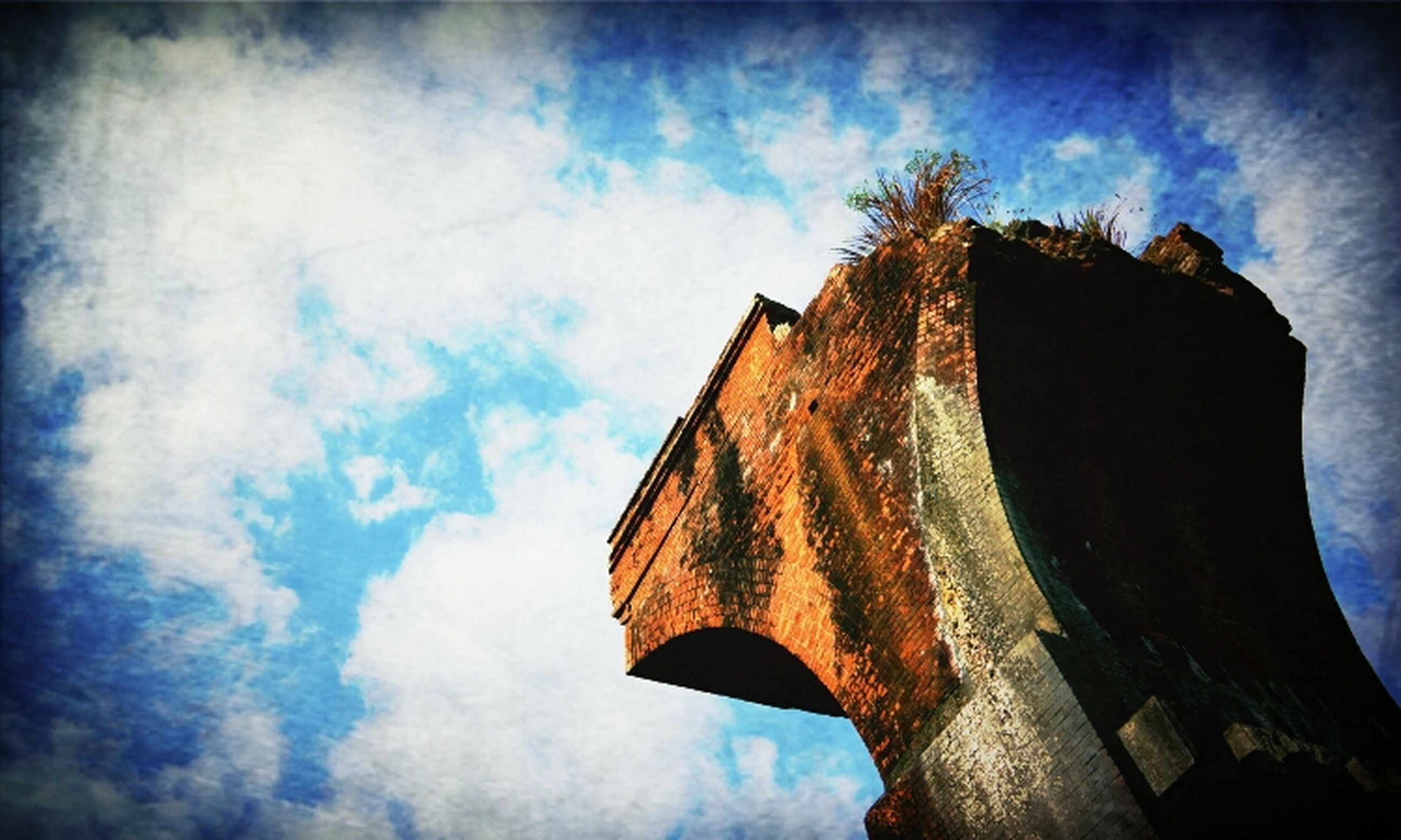 low angle view, built structure, architecture, sky, building exterior, cloud - sky, old, cloud, weathered, abandoned, damaged, wood - material, outdoors, no people, day, run-down, tree, deterioration, religion, obsolete
