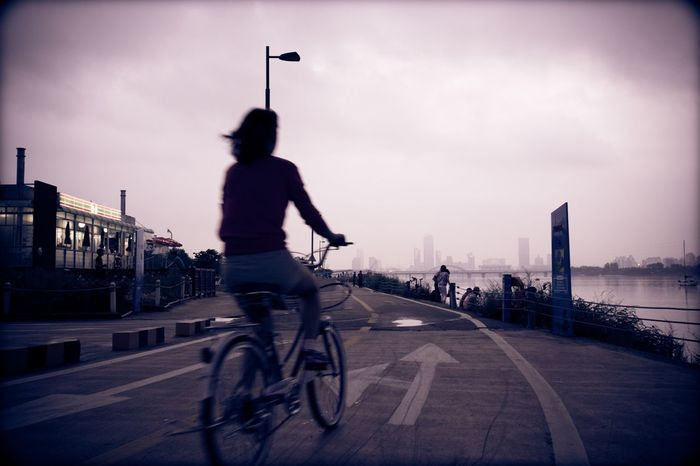 Han River Park Seoul, Korea Full Length City Bicycle Sky One Person Building Exterior Transportation Rear View Cycling Cloud - Sky Outdoors Cityscape Real People Men Day Architecture Headwear One Man Only Adult People