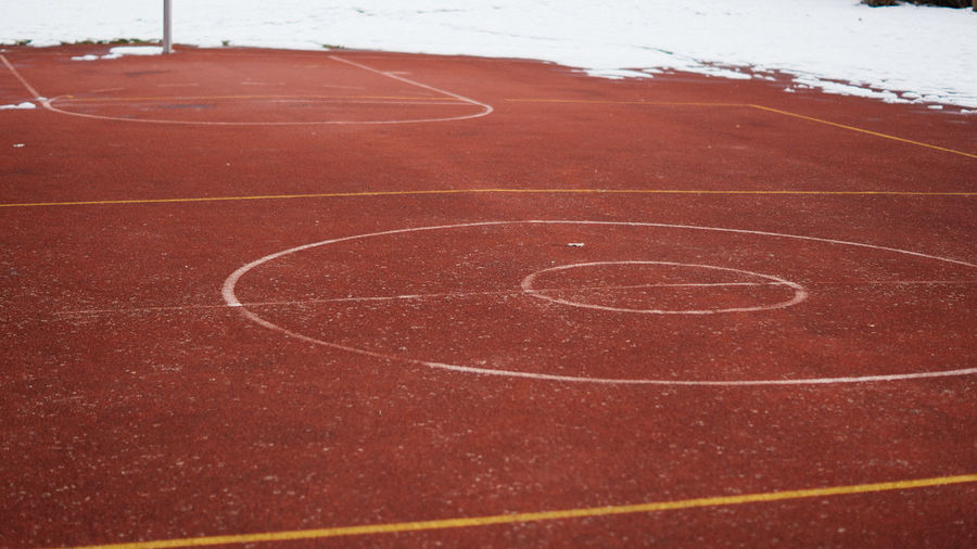 Empty basketball field in winter