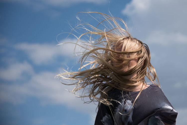 Portrait Of Teenage Girl Jumping On Trampoline