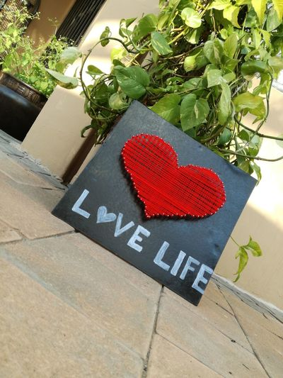 LoVeLiFe EyeEm Best Shots EyeEmNewHere Love Forever And Always Creativity Art Heart Wool Nails Weaving Cardboard Paint ❤❤❤ Communication High Angle View Text Red Close-up Architecture Plant Built Structure Capital Letter Written