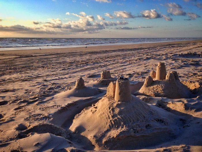 Sand castle on beach against sky