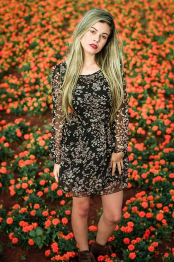One Person Long Hair Dress Only Women Flower One Woman Only Beauty People Young Adult One Young Woman Only Adult Front View Blond Hair Portrait Adults Only Young Women Beautiful Woman Fashion Pattern Looking At Camera Flowers
