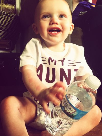 Sometimes, the simplest things can entertain us in our souls. Portrait Childhood Looking At Camera Smiling Real People Happiness Water Bottle  Babyboy Baby Toddlerlife Toddler  BabyRay