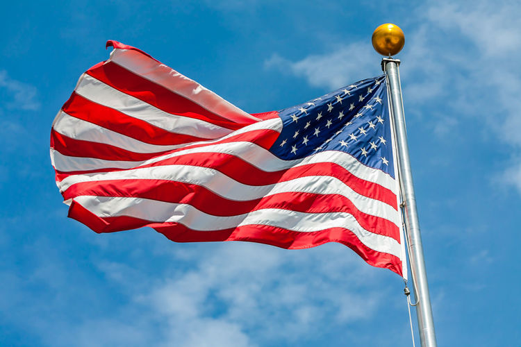 Old Glory American Flag Arts Culture And Entertainment Blue Clear Sky Cultur Direction Flag Flag Pole Guidance Identity Low Angle View National Flag Outdoors Patriotism Pole Safety Street Light Striped Symbol Wind