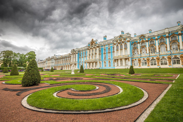 Panoramic view of garden against cloudy sky