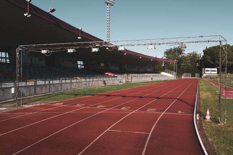 stadium running track starting line Sport Running Track Track And Field Architecture Built Structure Nature Sports Track Empty No People Grass Outdoors Direction Stadium Red Plant Absence Competition Tartan Track Athletics Running Stadium Speed Lanes