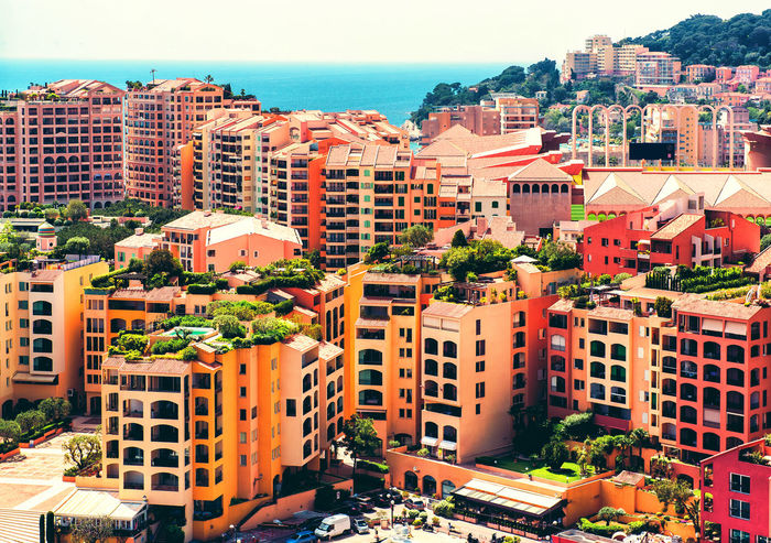 View of Fontvieille. Principality of Monaco Bright Colors City Cityscape Mediterranean Sea Monaco Aerial View Building Exterior Built Structure Colorful Europe Fontvieille Landmark Landscape Luxury Mountain Outdoors Principality Of Monaco Residential Building Scenery Sea Sunny Day Tourist Resort Travel Destinations Urban Landscape