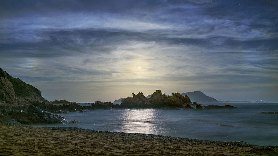 Beach Beauty In Nature Blue Clouds And Sky Full Moon Horizon Over Water Moon Moonlight Mysterious Nature Night No People Outdoors Sand Scenics Sea Shore Sky Tranquility Travel Destinations Water Wave