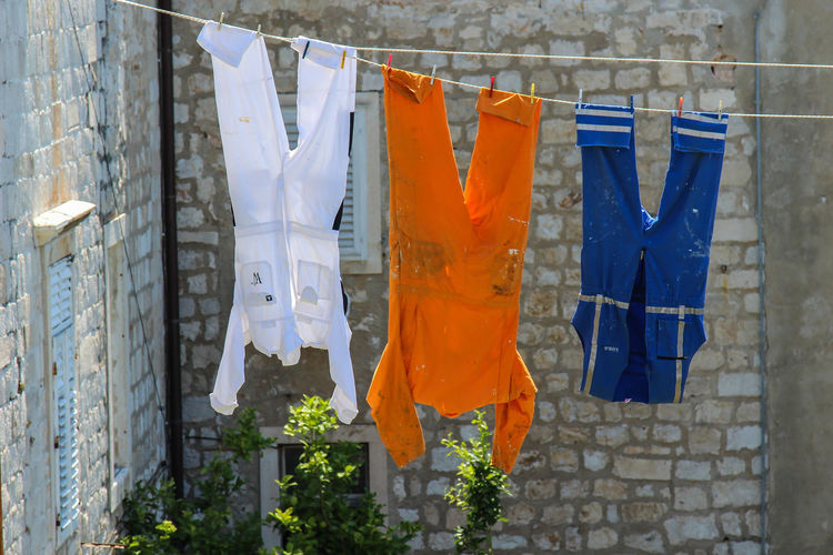 Chores Clothesline Clothespin Clothing Day Domestic Life Drying Hanging Laundry No People Outdoors Washing