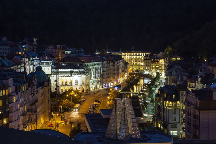 High angle view of illuminated buildings in city at night