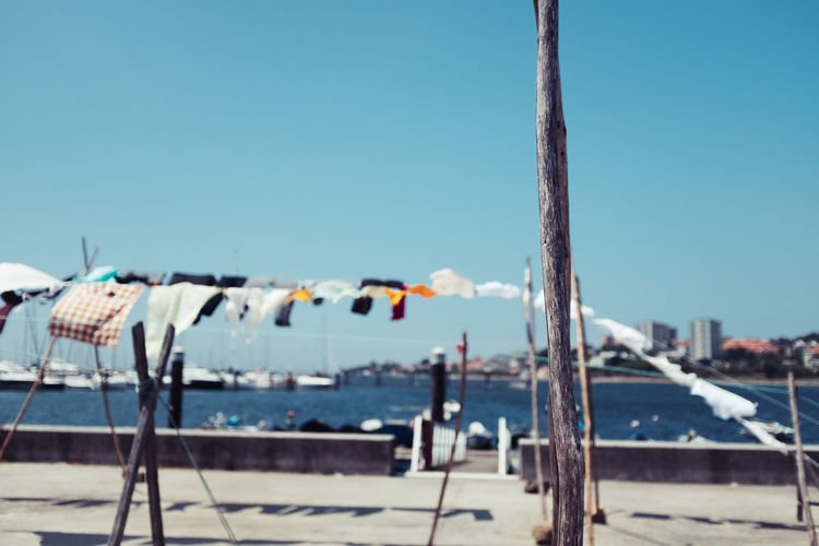 CLOTHESLINES OF AFURADA Clotheslines Threeweeksgalicia Sky Nature No People Day Outdoors Focus On Foreground Water Sea Clear Sky Sunlight Blue Nautical Vessel Beach Close-up Pole Metal Wood - Material Transportation Land Sailboat Moms & Dads