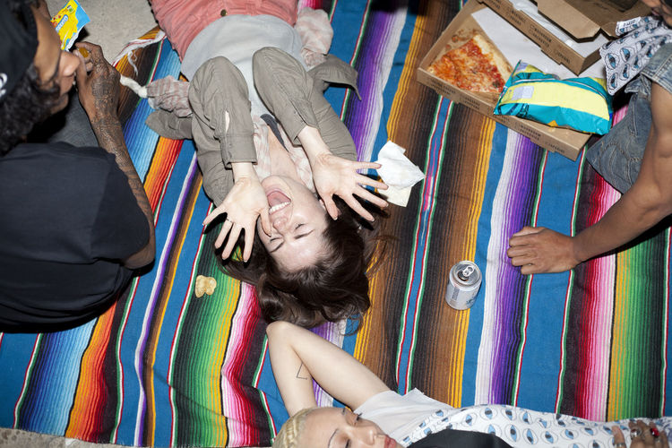 High angle view portrait of friends relaxing on floor