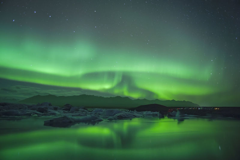 Beautiful northern lights over glacier lagoon in south east borealis up north in photography landscape with northern árlón glacier lagoon and Jökulsárlón glacier lagoon. EyeEmNewHere Aurora Borealis Iceland Jökulsárlón Night Photography Northern Lights Up North Artistic Photography Astronomy Beauty In Nature Fjallsárlón Fjallsárlón Glacier Lagoon Glacier Lagoon Idyllic Jökulsárlón Glaciar Lagoon Lagoon Nature Night No People Scenics - Nature Sky Star - Space Tranquil Scene Tranquility Water