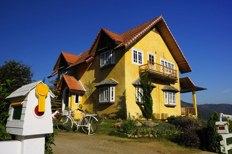 The Yellow House is located on a hill in the north, Thailand. Classic Mountain View Nature Winter Architecture Balcony Blue Building Exterior Built Structure Clear Sky Day Decoration Design Hill Homepage House Landscape Outdoors Postbox Residential Building Romantic❤ Sky Style ✌ Tree Yellow