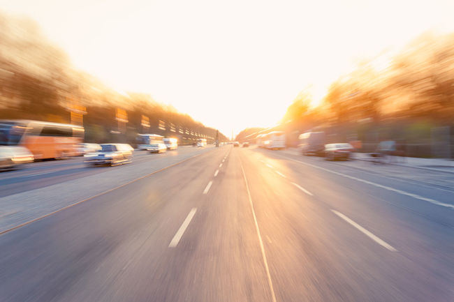 driving down a broad city street with high speed, motion blur zoom effect at sunset Berlin Blurred Motion Broad Car City City Day Driving High Speed Illuminated Mode Of Transport Motion No People On The Move Outdoors Road Road Sky Speed Street Sunlight Sunset Sunsets Transportation Urban