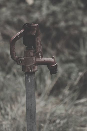 Focus On Foreground No People Metal Close-up Day Outdoors Nature Old Field Rusty Weathered Safety Wood - Material Technology Equipment Retro Styled Land