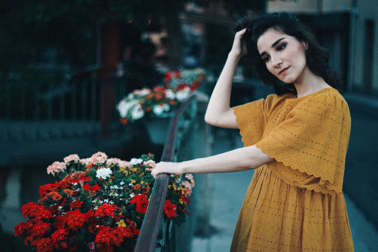 Portrait of a girl in a yellow dress in the south of france