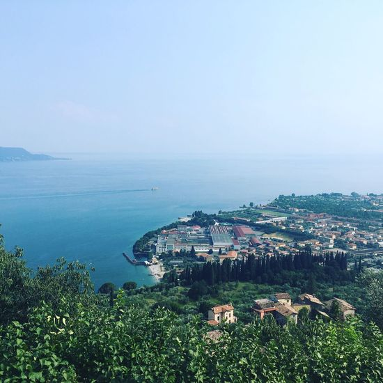 The view of Toscolano Maderno from the Church of S. Michele Arcangelo in Italy above Cecina, Lombardia Toscolano Maderno Lake View Lake Italy Summer Lake Garda Building Exterior Architecture Built Structure Sea Water Plant Sky Scenics - Nature Residential District