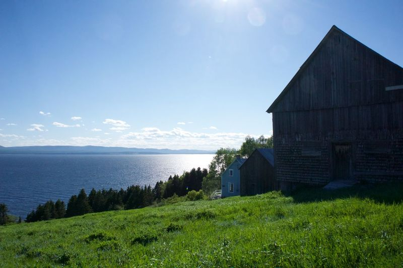 Architecture Beauty In Nature Building Exterior Built Structure Countryside Day Farm Forillon National Park Gaspesie Grass House Nature No People Old Buildings Outdoors Scenics Sea Travel Destinations Water