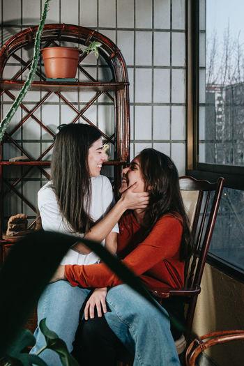 Lesbian women embracing at home