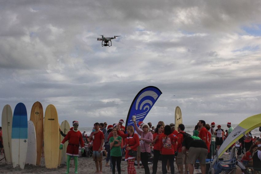 Drone photography in action Drone  Drone Photography Drone Flying Large Group Of People Flying Air Vehicle Surfing Santas Cocoa Beach, Florida Real People Crowd