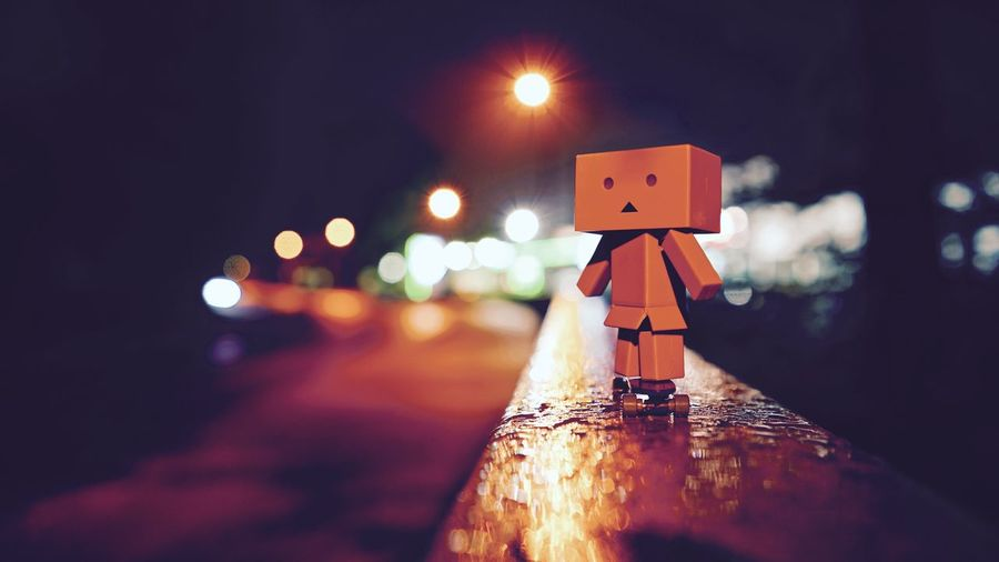 Meet Danbo in Germany on his Skateboard by Night and Illuminated from behind.