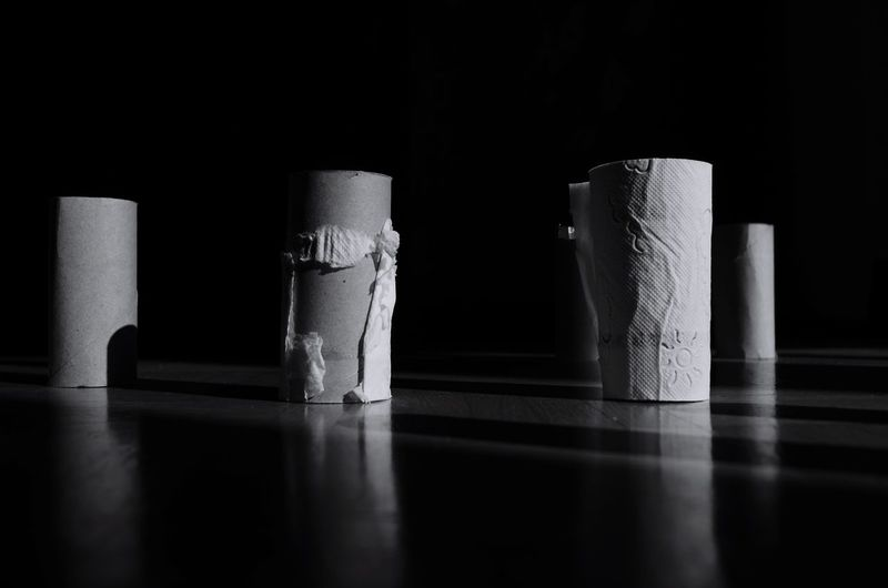 Close-up of empty tissue rolls against black background