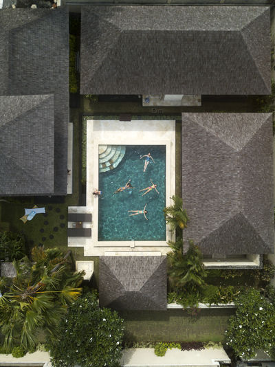 High angle view of cross in cemetery against building