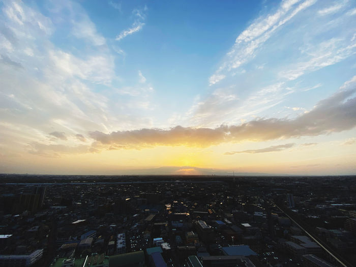 High angle view of buildings against sky during sunset