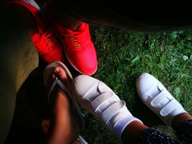 Low Section Grass Person Shoe Footwear Person Sitting Relaxation Personal Perspective High Angle View Standing Human Foot Jeans Torn Field Red Rubber Boot Resting Two Is Better Than One Color Palette Eyeemphoto Vibrant Color Shoe Shoes Feets Let's Go. Together.