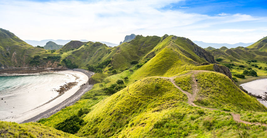 The Route to The Top Of Padar Island From the National Park, Indonesia Field Green Color INDONESIA Mountain View Top Tourist Trekking Walking Around Boat Hiker Hikers Island Mountain Nature Outdoors Padar Padar Island Pulau Route Tranquility Traveler Water