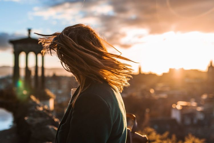 Best EyeEm Shot Weekend Getaway Travel Destinations Sunset Real People One Person Leisure Activity Long Hair Focus On Foreground Side View Lifestyles Women Waist Up Sunlight Young Women Adventures In The City