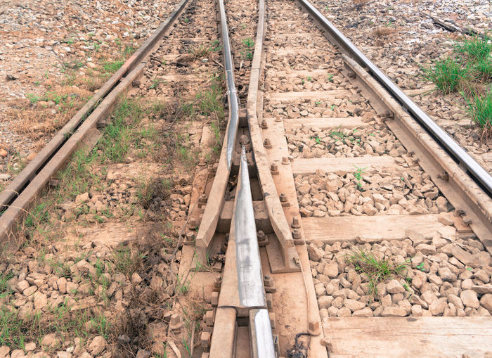 track changing point near railway station Angle Arrow Change Choice Choose Composition Direction Left Old Outdoor Parallel Perspective Point Rail Railing Right Select Sharp Steps Stone Track Train Turn Way Wood