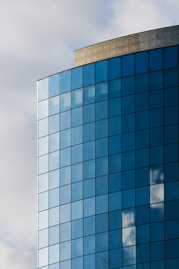 Sky Cloud - Sky Architecture Built Structure Glass - Material Building Exterior Reflection Modern Day Blue No People Low Angle View Nature Outdoors Building Office Office Building Exterior Shape Pattern City Turquoise Colored
