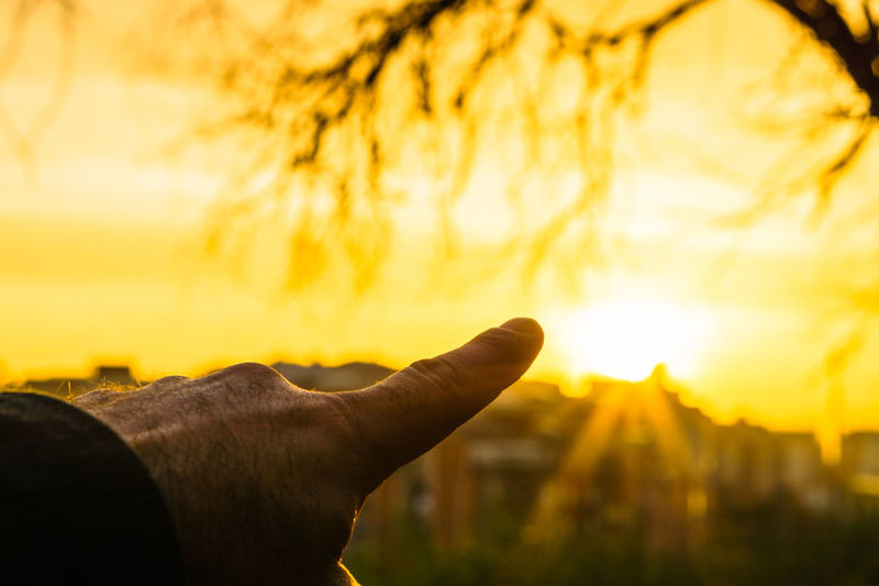 Sun Sunlight Sky Sunset Orange Color Nature Outdoors Beauty In Nature Sunrise Human Hand Hand Human Body Part One Person Human Finger Finger Body Part Focus On Foreground Real People Lifestyles Men Capture Tomorrow