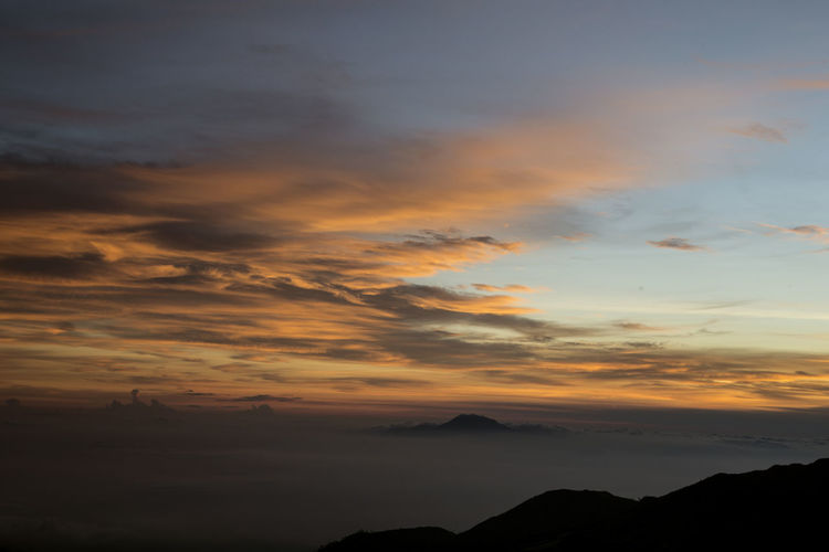 Sunrise at Mount Prau, Dieng Indonesia Backgrounds Beautiful Indonesia Beauty In Nature Cloud - Sky Clouds And Sky Creative Day Dramatic Sky Earth Landscape Mount Prau Nature No People Outdoors Poster Scenics Sky Sunrise Sunset Tranquil Scene Tranquility Travel Destinations Universe Wallpaper