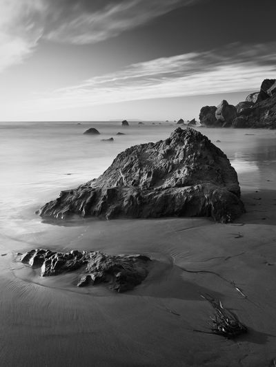 Long exposure black and white, rocks on sandy beach. Dillon Beach, CA. Sky Beauty In Nature Water Scenics - Nature Sea Tranquil Scene Tranquility Nature No People Rock Solid Outdoors Long Exposure Landscape Waves And Rocks Dillon Beach, CA Sea Stacks Sand Horizon Over Water Stack Rock Rock - Object Cloud - Sky Horizon Land Beach Rock Formation