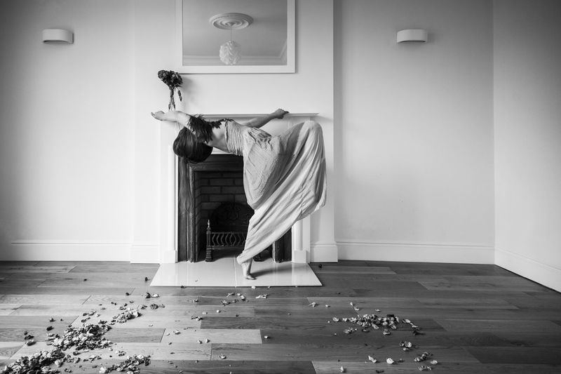 Woman dancing in room at home