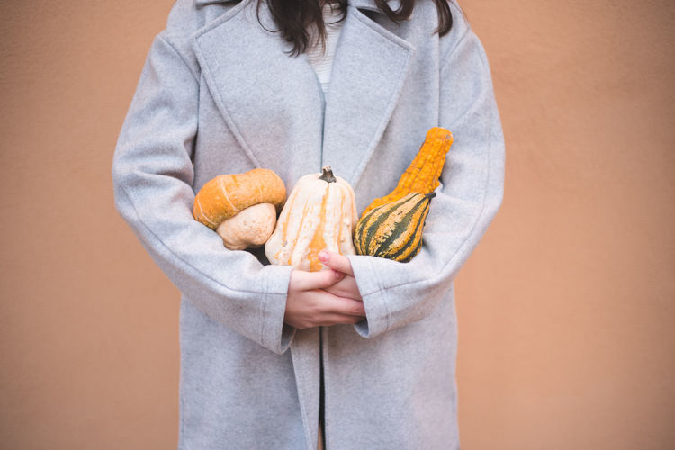 Autumn Mood One Person Holding Colored Background Midsection Food And Drink Food Studio Shot Indoors  Front View Casual Clothing Standing Wellbeing Healthy Eating Clothing Healthy Lifestyle Freshness Close-up Adult Human Body Part Beige Background