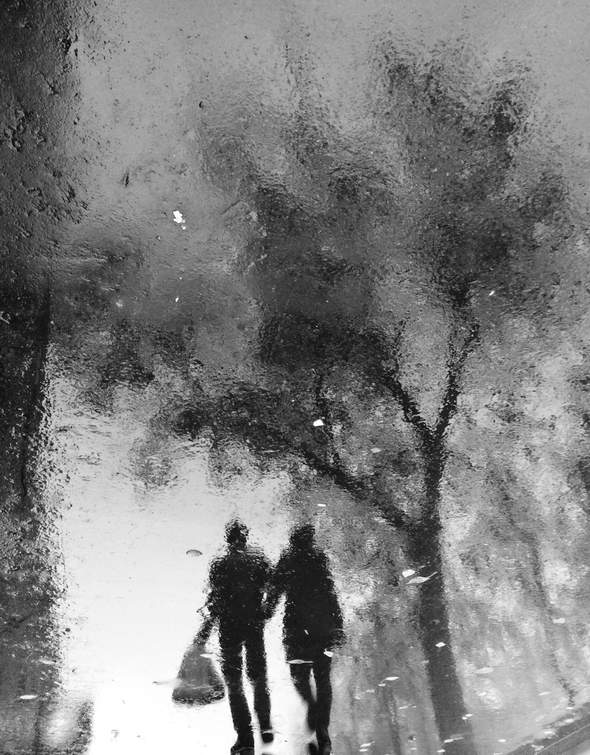 water, wet, lifestyles, rain, reflection, season, leisure activity, puddle, weather, walking, standing, silhouette, drop, men, street, high angle view, monsoon, person