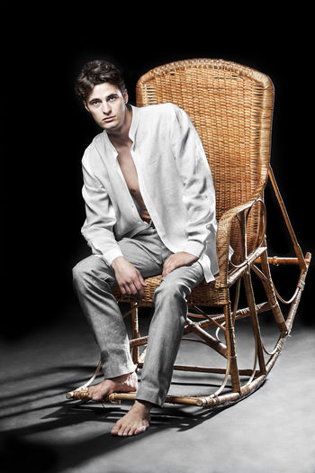 Portrait of man sitting on rocking chair