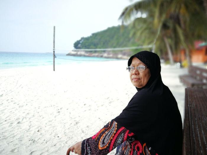 Portrait of mature man on beach