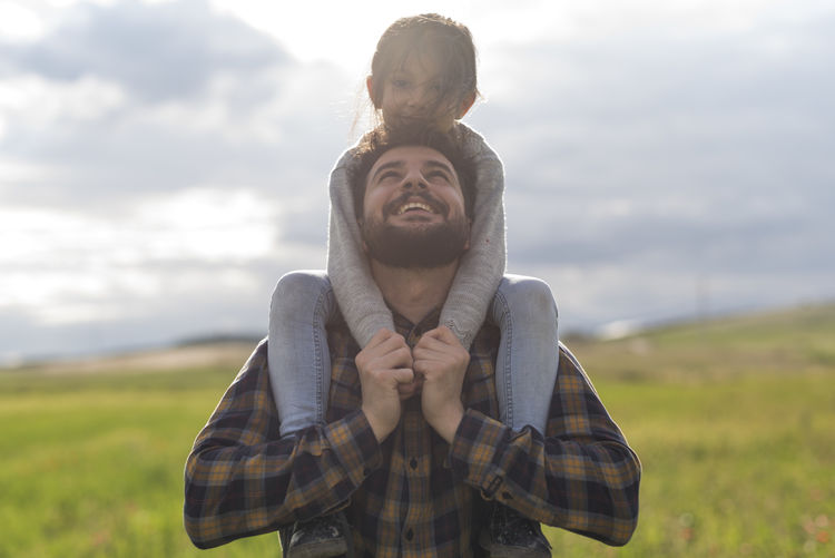 Father and little baby daughter in spring day 30 Years Old 30s Family Lifting Man Relationship Arab Beard Bearded Casual Clothing Cloud - Sky Daughter Day Embracing Emotion Father Fathers Day Field Front View Girl Happiness Leisure Activity Lifestyles Nature On Shoulders One Person Outdoors Parent People Portrait Positive Emotion Real People Sky Smiling Spring Standing Sunset Two People Waist Up Young Adult