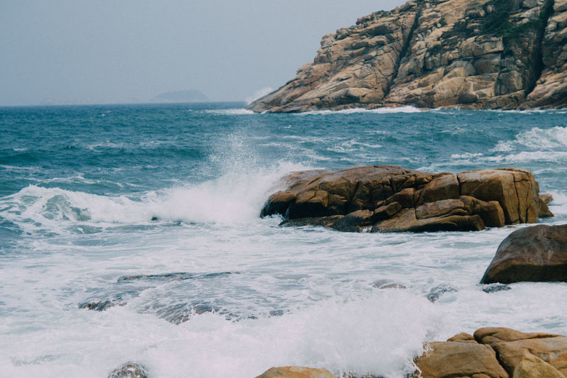 Sea Water Rock Rock - Object Solid Beauty In Nature Motion Scenics - Nature Wave Horizon Over Water Sport Beach Horizon Nature Sky No People Land Rock Formation Aquatic Sport Outdoors Power In Nature Hitting Breaking